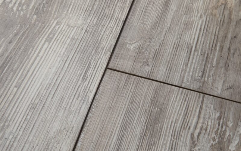 A close up image of gray colored wood look floor planks.