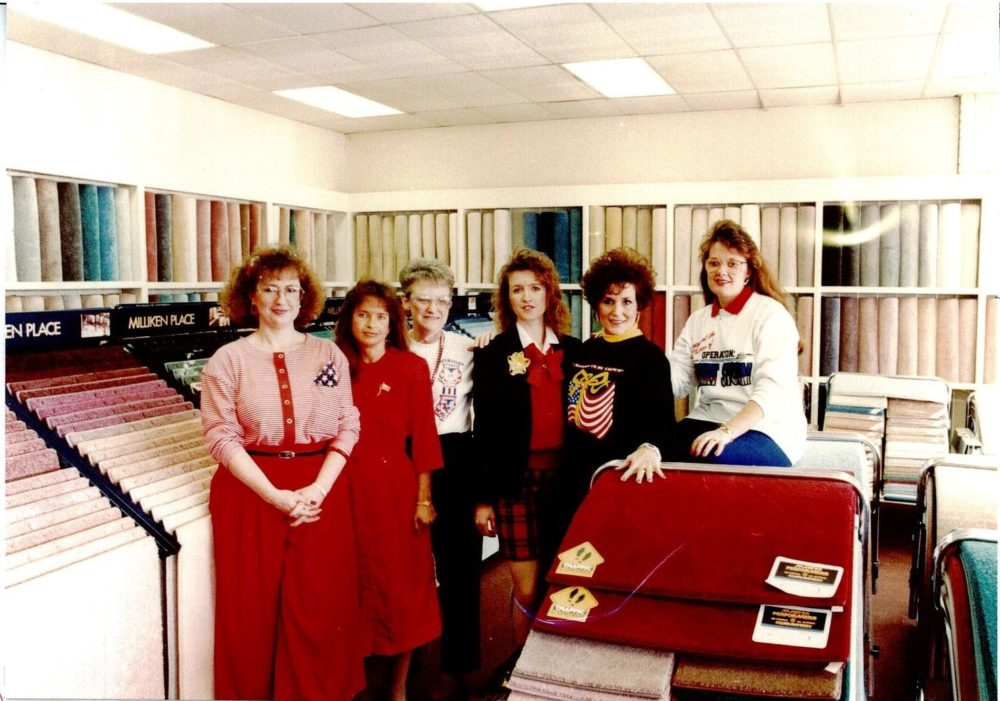Members of The Carpet Shoppe team pose in the showroom in 1991.