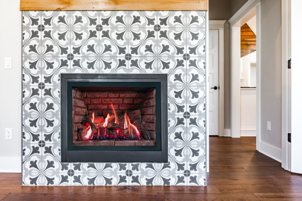 image of a gray spanish tile fireplace