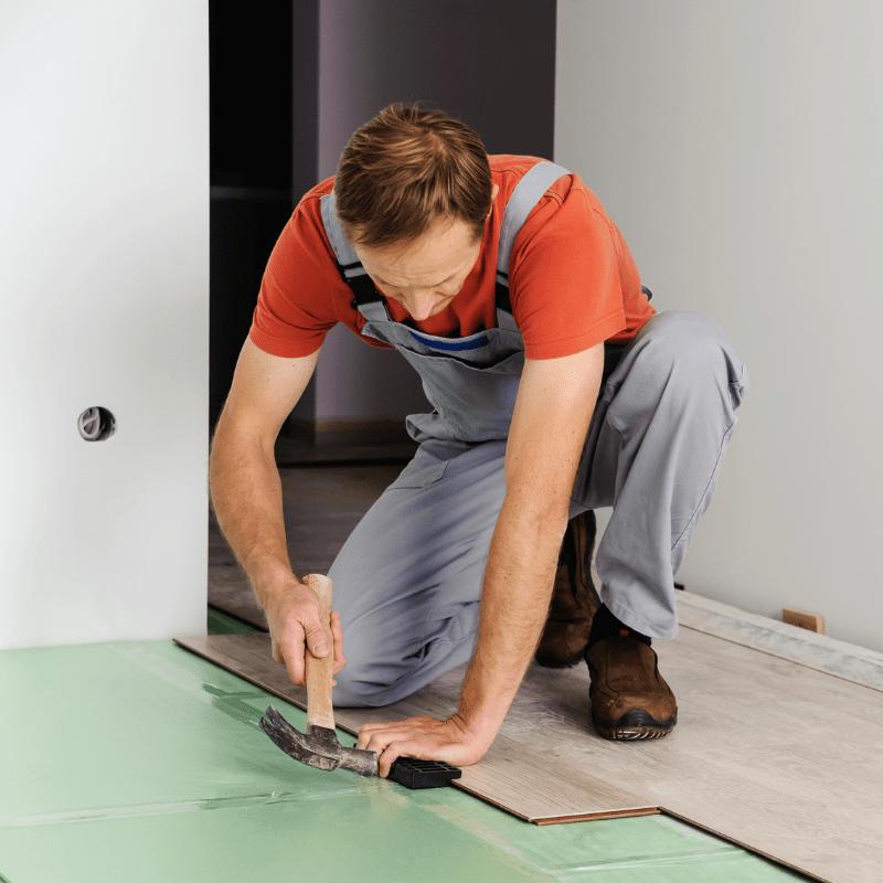 Man Laying Laminate Floor